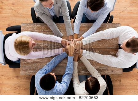 business, individuals, collaboration and cooperation idea - close up of imaginative group sitting at