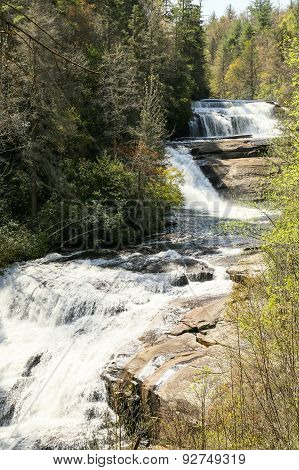 Triple Falls is in DuPont State Forest in North Carolina near Brevard off Rt 64.  It's a relatively easy hike on a well groomed path with great scenery. stock photo