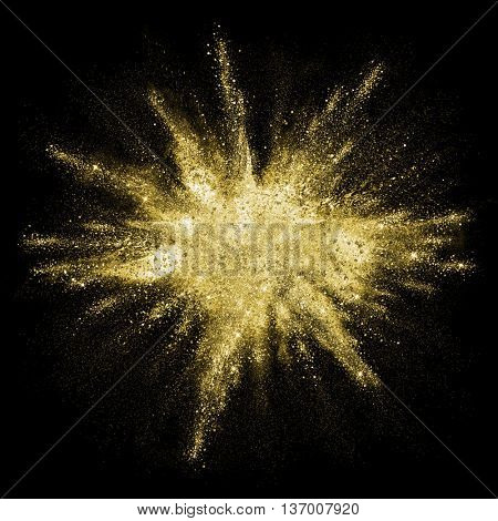 Gold powder particles explosion. Glitter burst with golden texture. Golden color dust splash for fas