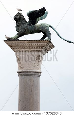 Bronze statue of the Lion of St Mark on the St Mark Piazzetta in Venice. The statue's origin is thought to be a Chinese chimera with wings added to make it look like a Venetian lion. stock photo