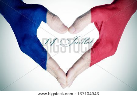woman hands forming a heart patterned with the flag of France and the text 14 juillet, 14th of July, the National Day of France, written in French stock photo