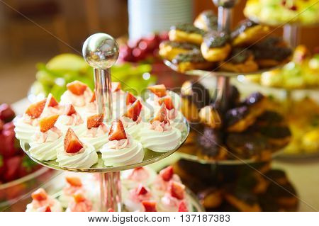 Dessert table for a party. akes and sweetness. Shallow dof stock photo