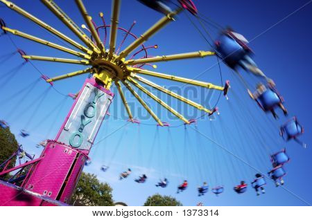 The Yo-Yo is a common amusement ride featured in carnivals state fairs and similar events. It resembles a series of swings arranged in a circle which turn just fast enough to be slightly affected by centripedal force.  stock photo