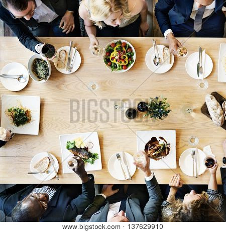 Business Meeting Eating Cheers Happiness Concept stock photo