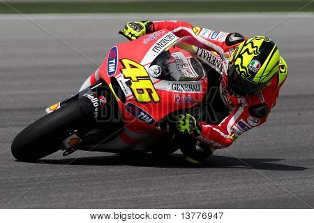 SEPANG MALAYSIA - Ducati Team rider Valentino Rossi of Italy in action during the 2011 pre-season test at Sepang circuit February 3 2011 in Sepang Malaysia. stock photo