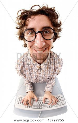 Fish-eye shot of a smiling tousled nerd typing on the keyboard stock photo