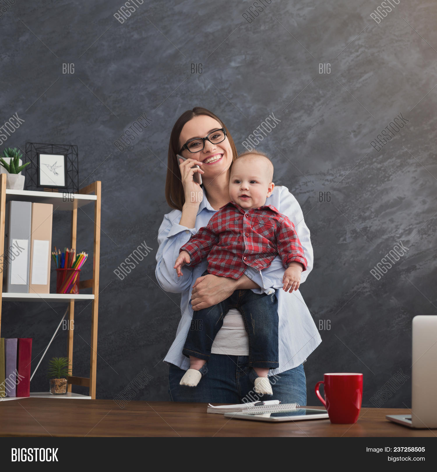 adult,apartment,baby,background,beautiful,boy,business,businesswoman,busy,call,caucasian,cellphone,child,computer,couch,crop,family,female,girl,happy,holding,home,indoors,infant,job,kid,laptop,maternity,modern,moderntechnology,mom,mommy,mother,motherhood,office,parent,parenthood,people,phone,smartphone,smile,son,table,talk,toddler,two,woman,work,young