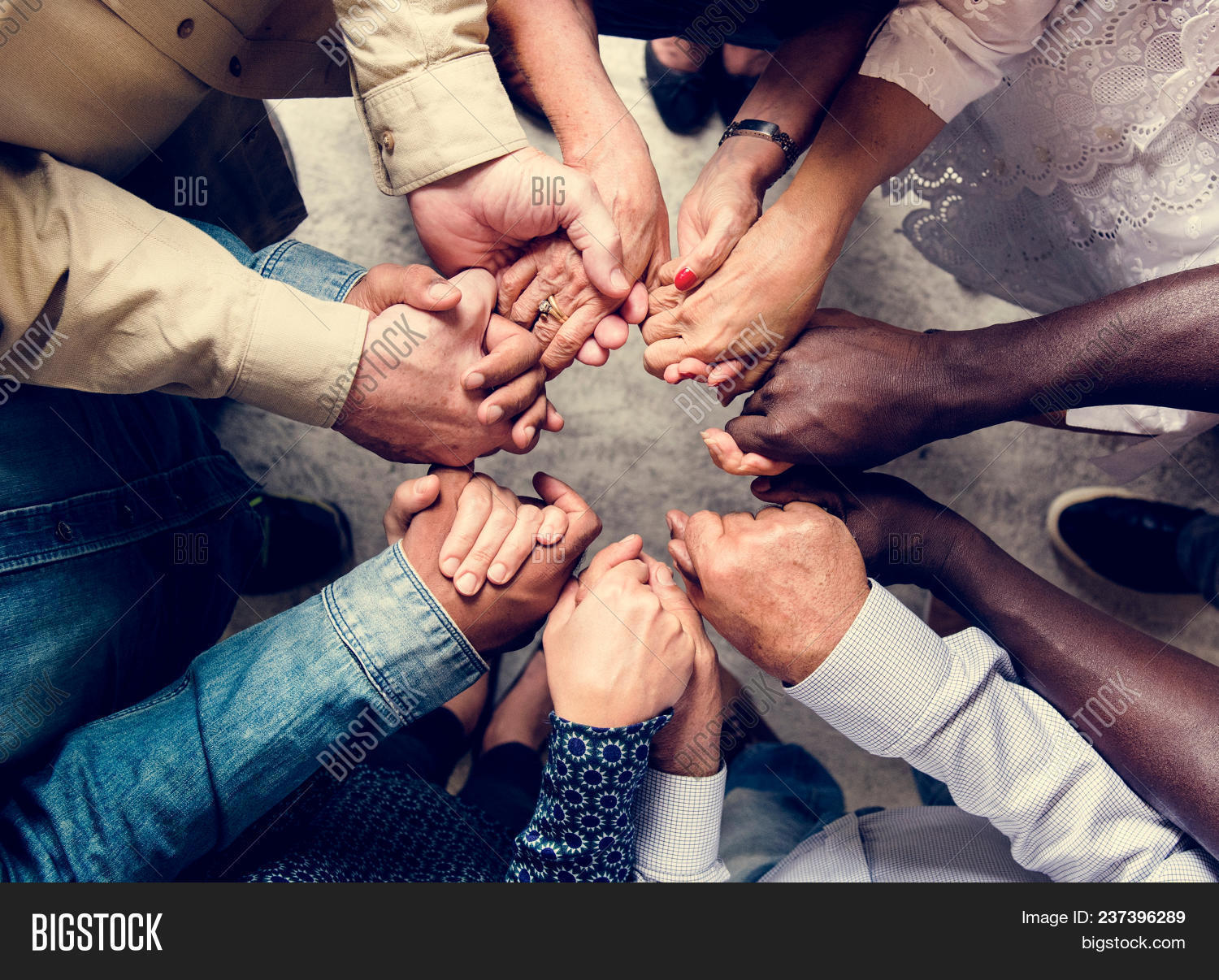 assemble,circle,closeup,community,diverse,gather,group,hands,help,holding,interaction,people,pray,support,team,teamwork,together,unity