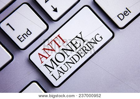 Word writing text Anti Monay Laundring. Business concept for entering projects to get away dirty money and clean it written White Keyboard Key with copy space. Top view. stock photo