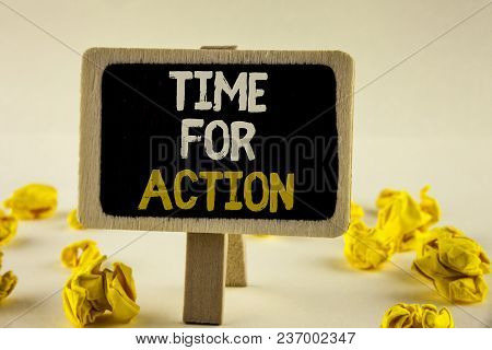 Handwriting text Time For Action. Concept meaning Do something now for a particular purpose Act in this moment written Wooden Notice Board the plain background Paper Balls next to it. stock photo