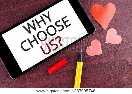 Writing note showing  Why Choose Us Question. Business photo showcasing Reasons to select our Services Products or Offers written Mobile Phone Screen wooden background Pen and Hearts stock photo