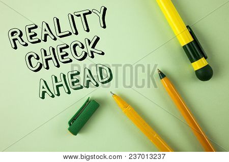 Word writing text Reality Check Ahead. Business concept for Unveil truth knowing actuality avoid being sceptical written Plain Green background Pens next to it. stock photo