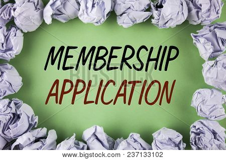 Handwriting text writing Membership Application. Concept meaning Registration to Join a team group or organization written plain grean background within White Paper Balls. stock photo