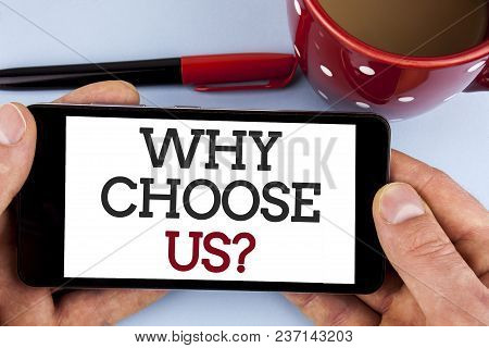 Word writing text Why Choose Us Question. Business concept for Reasons to select our Services Products or Offers written Mobile Phone Screen holding by man the plain background Cup Marker stock photo
