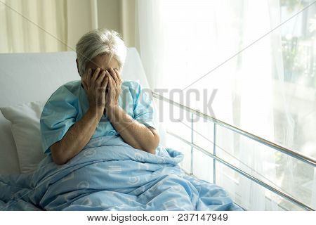 Lonely Elderly patients in hospital bed patients want to go home - medical and healthcare concept stock photo