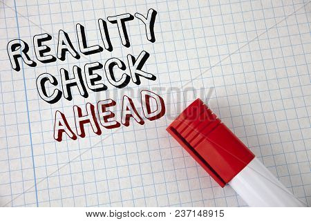 Handwriting text Reality Check Ahead. Concept meaning Unveil truth knowing actuality avoid being sceptical written Notebook Paper Marker next to it. Top view. stock photo
