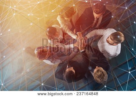 Business People Putting Their Hands Together In Office With Internet Network Effects. Concept Of Int