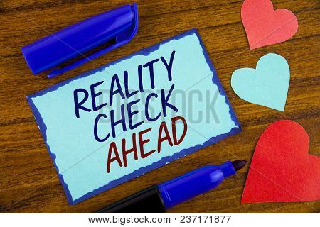 Writing note showing  Reality Check Ahead. Business photo showcasing Unveil truth knowing actuality avoid being sceptical written Sticky note paper the wooden background Hearts next to it stock photo