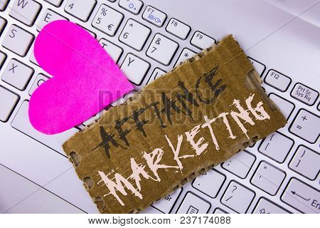 Word writing text Affiance Marketing. Business concept for joining two or more companies in same field mutual goal written Tear Cardboard Piece placed the Laptop Pink Heart next to it. stock photo