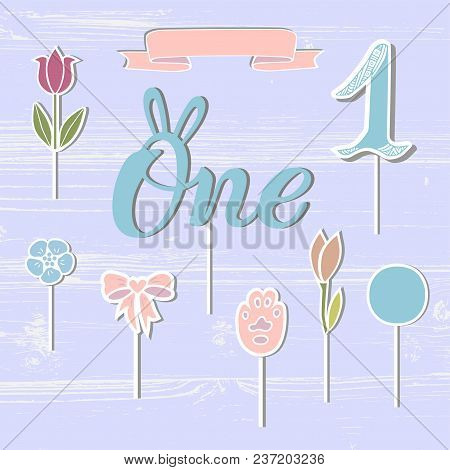 Vector set with One, flowers, paw, ribbon. One handwritten lettering as patch, stick cake toppers, laser cut plastic, wooden toppers. Props for First Year Baby Anniversary, Birthday party. stock photo