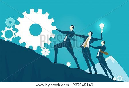 Group of business people rolling ip the gear, towards the top of the mountain. Risky situation which might bring winning. Business success concept stock photo