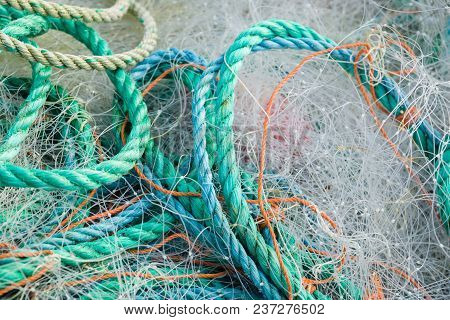 A tangled mess of fishing nets plastic rope and other debris washed up on a coastal beach ideal for an ecological hazard or pollution concept stock photo