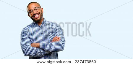 African american man with beard with crossed arms confident and happy with a big natural smile laugh