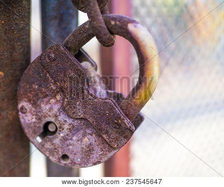 Old lock on the door. lock on the door of an old farmhouse . true village style . close-up. focus on lock stock photo