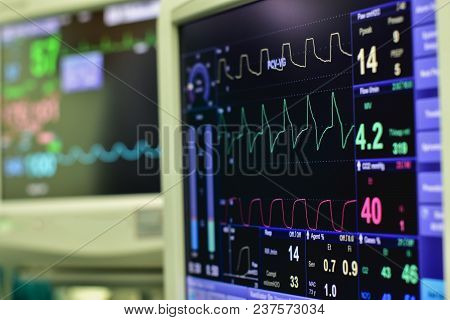 EKG monitor in intra aortic balloon pump machine in icu on blur background, Brain waves in electroencephalogram, heart rate wave stock photo