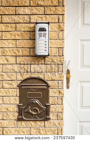 Intercom and mailbox built-in brick wall at the door of the apartment building stock photo