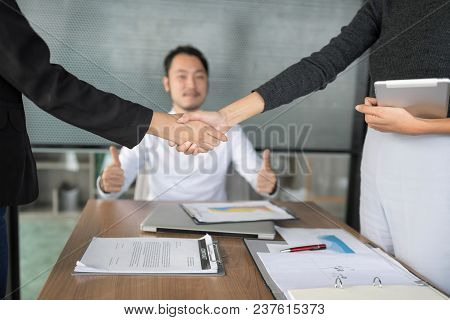 Business partners shaking hand after complete a deal.  Business Team Partnership Greeting Handshake Concept. Set up studio shoting. stock photo