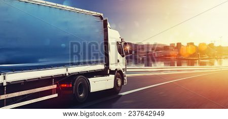 Moving truck on the highway with city background stock photo