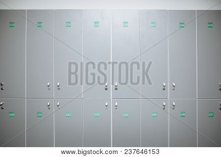 Lockers in a locker room at school or in the gym stock photo