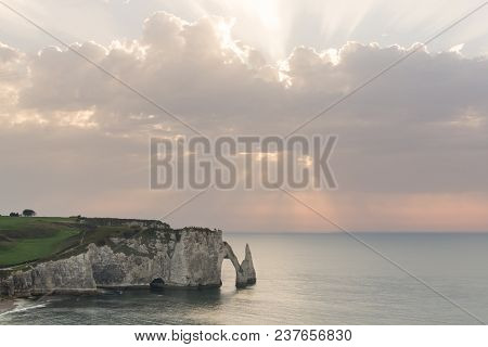 Sunset view of L'Aiguille or the Needle rock and Porte d'Aval at Etretat, a commune in the Seine-Maritime department in the Normandy region of north western France stock photo