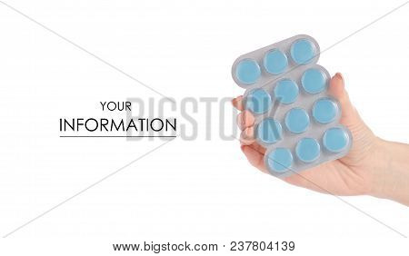 Medicine lozenges for the throat in blister in hand pattern isolated on white background. Pharmacy and medication. stock photo