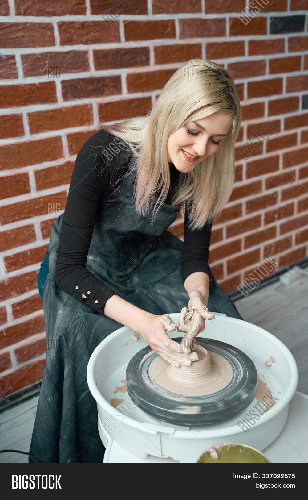 art,artisan,artist,business,ceramic,clay,craft,craftsman,creative,creativity,earthenware,entrepreneurs,female,form,freelance,hand,handcraft,handicraft,handmade,handwork,hobby,ingot,learning,making,master,molding,mud,occupation,people,pot,pottery,sculptor,shape,skill,smile,smiling,turn,vertical,wheel,woman,work,working,workpiece,workshop