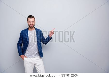 Portrait of his he nice attractive imposing cheerful cheery bearded gentleman in checked blazer showing copy empty blank place space advert isolated over light grey pastel color background stock photo