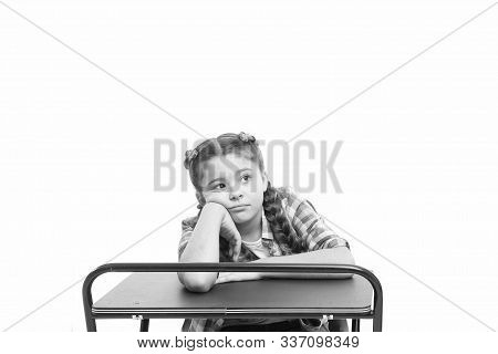 Boring lesson. Girl bored pupil sit at desk. Issues of formal education. Back to school concept. Kid cute tired of boring studying. Boring educational program. Need some rest and entertainment. stock photo