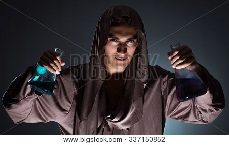 Alchemist doing experiments in alchemy concept stock photo