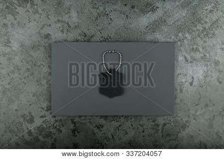 piece of leather on a black background. place for an inscription. black leather on a black background. stock photo