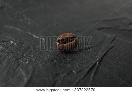 Coffee bean on black background, close up and space for text stock photo