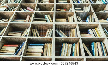 Bookshelves with books close-up. Education concept, close up stock photo