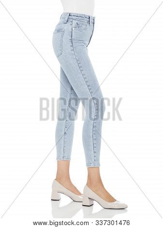 Crease & Clips Slim Women's Light Blue Jeans, Double Black jeans - Fade Resistant This mid-rise jeans, super skinny hugs every contour of the body, from hip to hem jean... stock photo