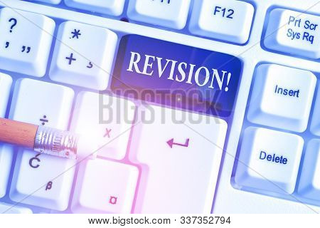 Handwriting text Revision. Concept meaning action of revising over someone like auditing or accounting White pc keyboard with empty note paper above white background key copy space. stock photo