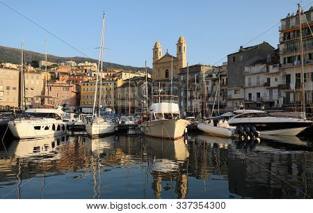 View of St Jean Baptiste cathedral and old port of Bastia , second largest corsican city and main entry point to the island stock photo