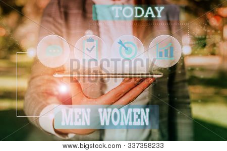 Text sign showing Men Women. Conceptual photo The state where in a boy or a girl turns to be a mature adult Female human wear formal work suit presenting presentation use smart device. stock photo
