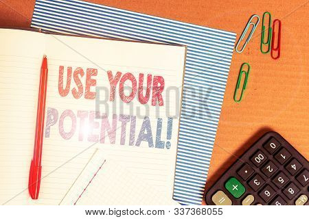 Word writing text Use Your Potential. Business concept for achieve as much natural ability makes possible Striped paperboard notebook cardboard office study supplies chart paper. stock photo
