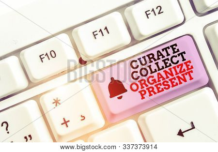 Writing note showing Curate Collect Organize Present. Business photo showcasing Pulling out Organization Curation Presenting White pc keyboard with note paper above the white background. stock photo