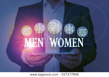 Writing note showing Men Women. Business photo showcasing The state where in a boy or a girl turns to be a mature adult Male wear formal work suit presenting presentation smart device. stock photo