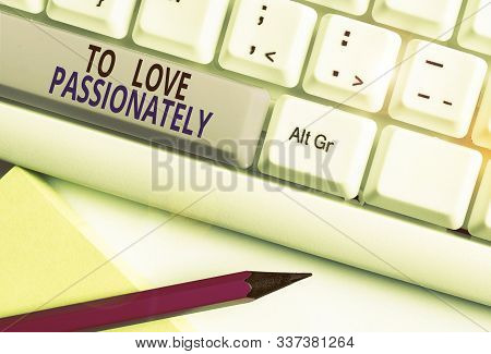 Text sign showing To Love Passionately. Conceptual photo Strong feeling for someone or something else Affection White pc keyboard with empty note paper above white background key copy space. stock photo